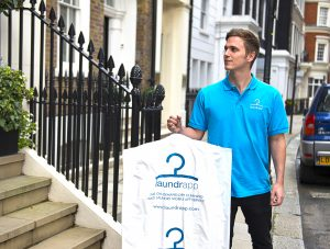 Laundrapp App staff, delivering laundry on demand, wearing their blue uniform